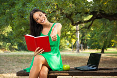 Female student showing thumbs up Stock Image