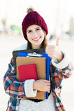 Female student showing thumbs up Stock Photo