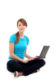Female student sitting with laptop. Isolated Royalty Free Stock Photos