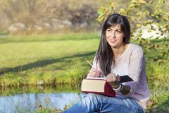 Young Woman  Studying with Books for Exams Outdoor Royalty Free Stock Photos
