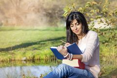 Young Woman  Studying with Books for Exams Outdoor Stock Images