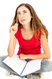 Female student sitting and thinking Royalty Free Stock Photos
