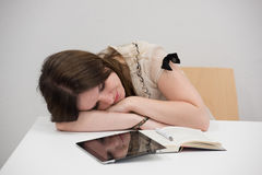 Female student sleeping in classroom Royalty Free Stock Photo