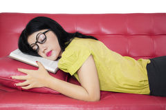 Female student sleeping on the couch Royalty Free Stock Images