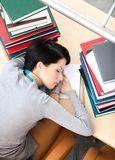 Female student sleeping at the desk Royalty Free Stock Images