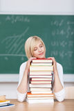 Female Student Sleeping On Stacked Books Royalty Free Stock Photo