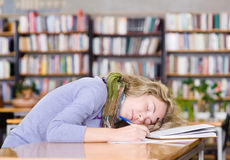 Female student sleeping in a university library.  stock photography