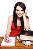 Female student smiling with books. Brunette girl smiling and acting all'studenty royalty free stock photos