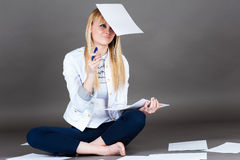 Female student smiling falling sheet of paper Royalty Free Stock Image