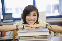 Female Student With Stack Of Books In Library Royalty Free Stock Photography
