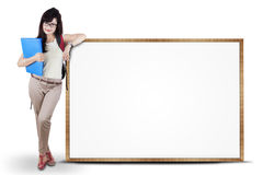 Female student standing next to copyspace Royalty Free Stock Photo