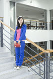 A female student standing on the stair Royalty Free Stock Images
