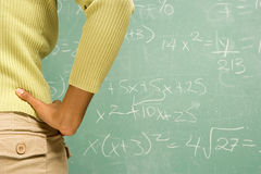 Female student stood in front of blackboard Royalty Free Stock Photo