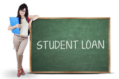 Female student and student loan text Royalty Free Stock Photography