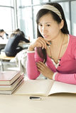 A female student is studying Stock Images