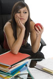 Female student when studying with apple Royalty Free Stock Images