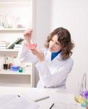 Female student studying chemistry Stock Image