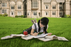Female student studying on grass Royalty Free Stock Photography