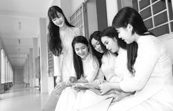 Female student studying lessons inside school hallway Royalty Free Stock Photos