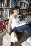 Female Student Studying In Library Stock Photo