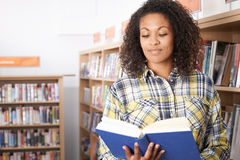 Female Student Studying In Library. Female Student Studies In Library Stock Photo
