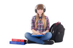 Female student studying and listening music Royalty Free Stock Images