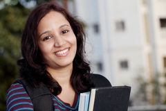 Female student studying outdoors Royalty Free Stock Photo
