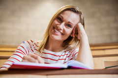 Female student taking notes in a class Stock Images