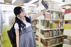 Female student taking self portrait Royalty Free Stock Image