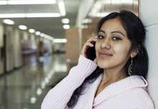 Female student talking on mobile phone royalty free stock images