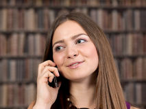 Female student talking on the phone. Royalty Free Stock Image