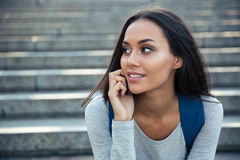 Female student talking on the phone Royalty Free Stock Images