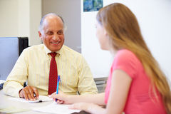 Female Student Talking To High School Councillor Stock Photography
