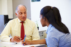Female Student Talking To High School Councillor Royalty Free Stock Images