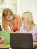 Female student and teacher tutor in classroom Stock Photos