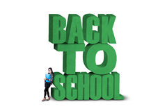 Female student and a text of back to school Royalty Free Stock Photos
