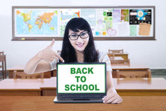 Female student and a text of back to school Stock Images