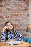 Female student thinking about her homework Royalty Free Stock Photo