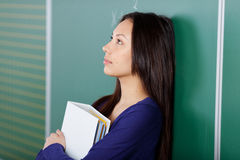 Female student in thoughts Royalty Free Stock Photography