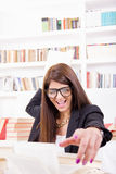 Female student throwing a book Stock Photo