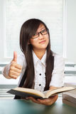 Female student with thumb up Royalty Free Stock Image