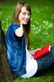 Female student with thumbs up Royalty Free Stock Photography