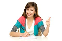 Female student with thumbs up Stock Image