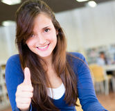 Female student with thumbs up Stock Photo