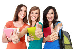 Female student together showing thumbs up Royalty Free Stock Photo