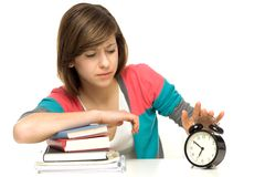Female student turning off alarm clock Stock Image