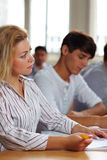 Female student in university class Royalty Free Stock Image