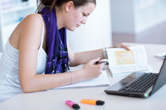 Female student  in the university library Stock Image