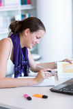 Female student  in the university library Stock Photography