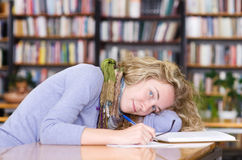 Female student in a university library Royalty Free Stock Photo